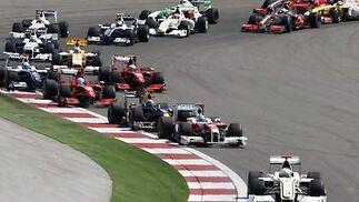 Vettel, perseguido por Button.  Foto: AFP Photo / Reuters / EFE