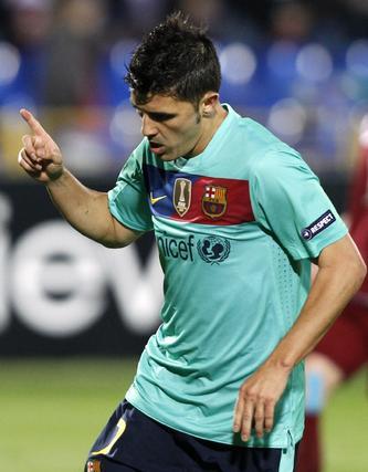 Villa celebra el empate del Barcelona, marcado de penalti. / Reuters