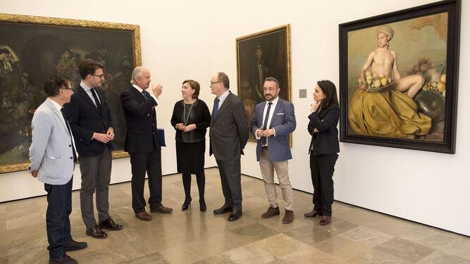 Luis M. Linde, gobernador del Banco de España, junto a personalidades políticas.